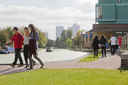 Students enjoying a walk along the canal at Mile End