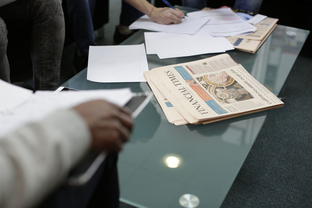 A table with documents and the Financial Times on it