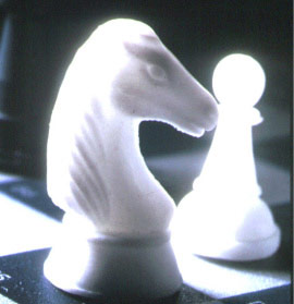 A chess piece made of glass