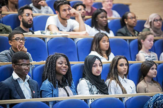 Queen Mary University of London students in a lecture theatre