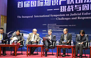 Professor Duncan Matthews speaks on anti-suit injunctions at the 1st International Symposium on Judicial Protection for Intellectual Property in Beijing on 18 January 2020, organised by Renmin University of China Law School. Seated with Mark Cohen (University of California, Berkeley) and Professor Guo He (Vice President and Secretary General of the China Law Society Intellectual Property Law Association)