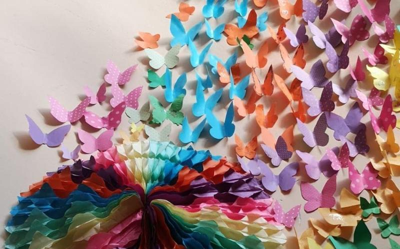 A paper collage of colourful butterflies made during the project