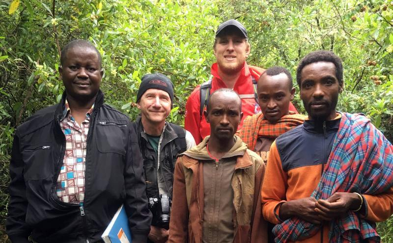 The team in the field: Dr Faulkes (with camera), Georgies Mgode (with notebook, co-author on the species description paper), Daniel Hart (in red) and three villagers from the Mt Hanang area