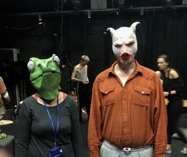Two people wearing masks