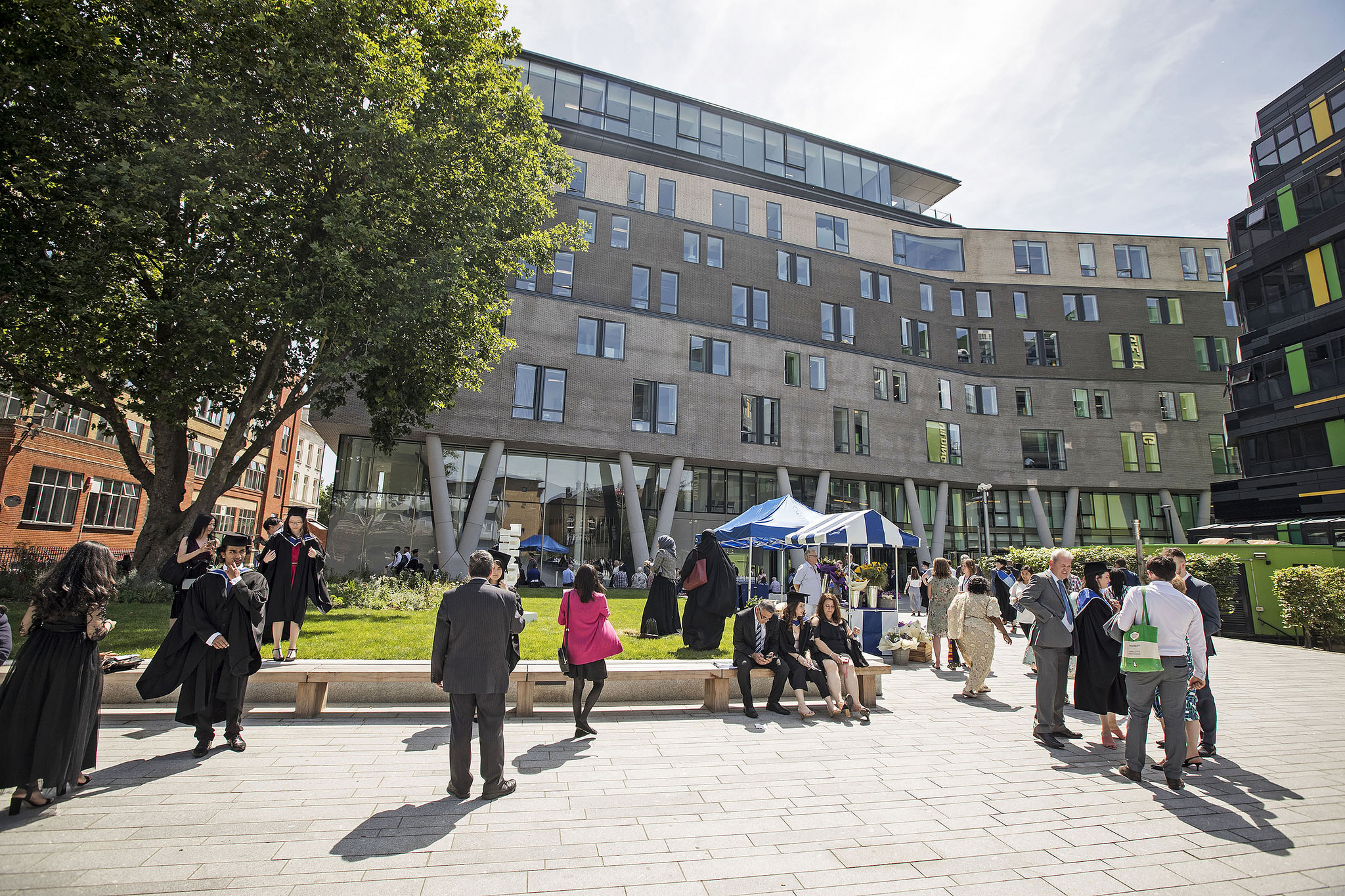 A sunny scene of people walking outside the Graduate Centre, the home of the School of Economics and Finance