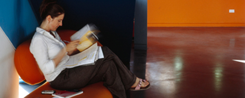 Student sitting on a chair reading